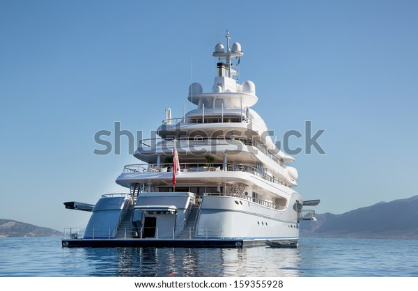 Rich - front view of five story luxury yacht on the Mediterranean Sea