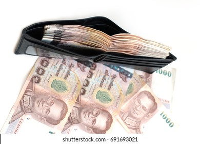 Rich full wallet on white background