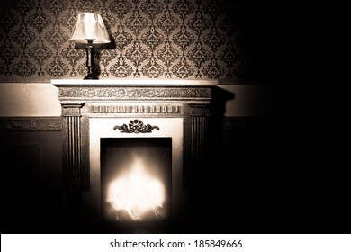 Rich interior with antique lamp and fireplace in red vintage room studio shooting