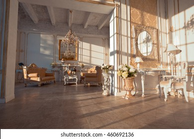 rich interior of studio with gold decorations on the walls at sunset time