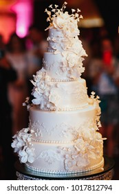 Rich layered wedding cake decorated with white flowers