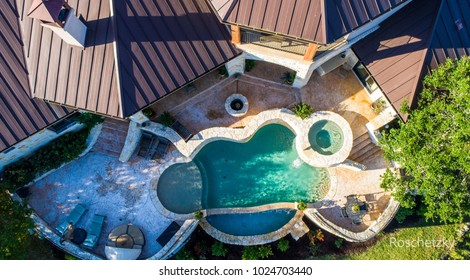 Rich Luxury Mansion Country home north of Austin , TX in the Ranch lands of Georgetown, Texas circle patterns around a Infinity pool bring elegance and luxury to the backyard.