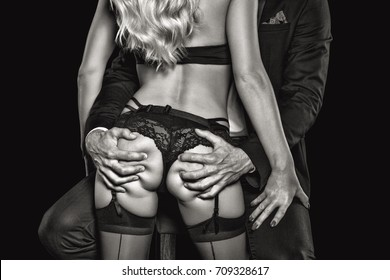 Rich man grab sexy blonde lover ass in nightclub closeup, black and white