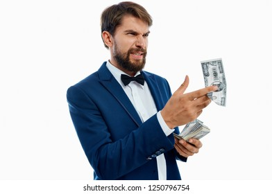 rich man holding bills in his hands