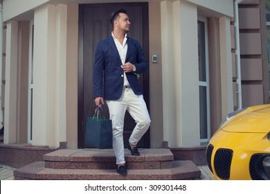 Rich man leaving house