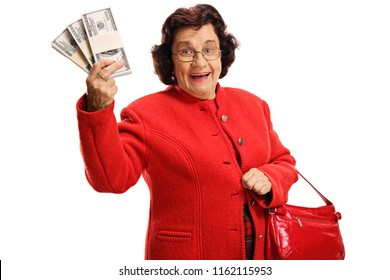 Rich mature woman holding money and purse isolated on white background
