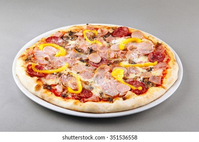 Rich meat pizza with salami, sausages, ham, barbecue chicken, parmesan sheece and bell pepper