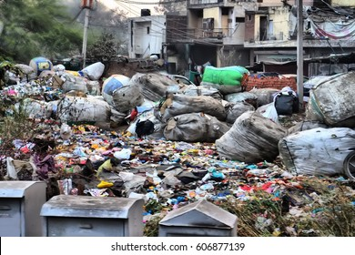 Rich produce debris - poor make money on rich. Garbage as profession (picker). Collection sorting and selling garbage. District of poverty (pockets of poverty) in India. Waste and old things
