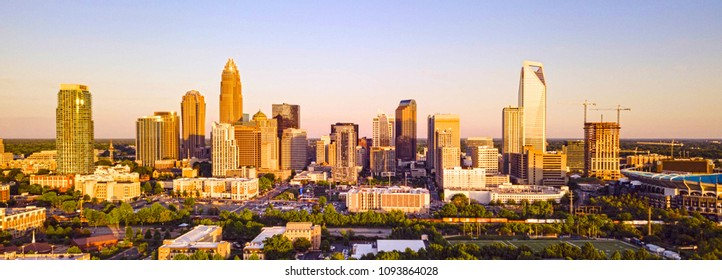 Rich sunset light washes Charlotte in color for a saturated look in this aerial panoramic view