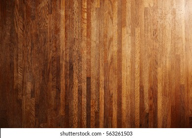 Rich texture of wooden table or floor made of many thin long racks placed vertically, top view, natural rustic background