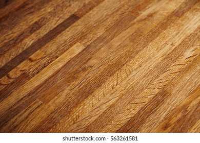 Rich texture of wooden table or floor made of many thin long racks placed horizontally, side view, artisan rustic background