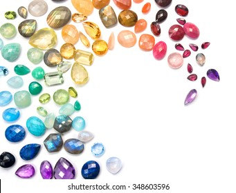Rich variety of real colorful gemstones on the white background.
