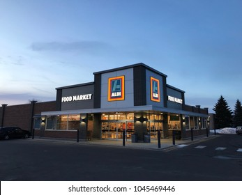 Richfield, MN/USA- March 13, 2018. The outside of an Aldi Food Market store at dusk in Minnesota.
