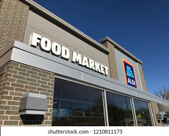 Richfield, MN/USA- October 20, 2018. The side entrance of an Aldi Food Market with a blue sky.
