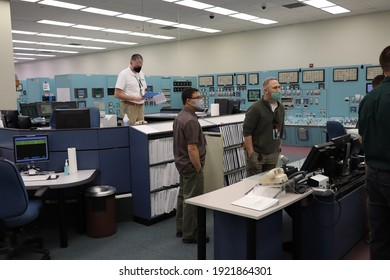 Richland, WA, USA - Feb 02, 2021: Students and instructors training in a power plant control room simulator wearing masks during pandemic