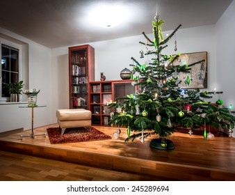 Richly decorated Christmas tree in a cool, modern home library