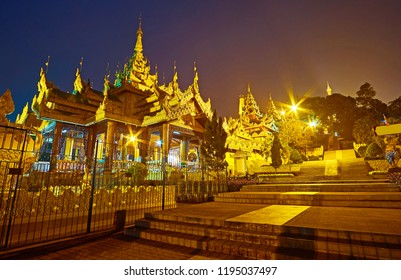 The richly decorated    North Gate gallery with pyatthat roofs and carved decors, leading to the top of Singuttara Hill and Shwedagon Zedi Daw, Yangon, Myanmar.