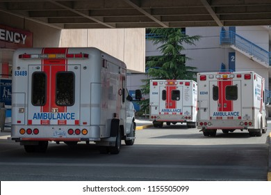 Richmond, BC / Canada - August 2nd 2018 - Several Ambulances Parked out front of the Emergency Department at Richmond Hospital.