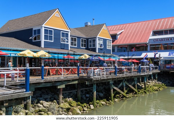 RICHMOND, BC, CANADA - JULY 08, 2014: Unidentified people enjoying sunny day in Steveston Village in Richmond. Steveston is a historic fishing village. It has become a popular place to visit and live.
