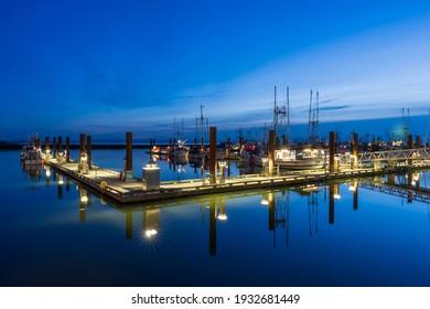 Richmond, BC, Canada - MAR 03 2021 : Steveston Harbour Fisherman's Wharf at night.