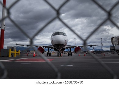 RICHMOND, BC, CANADA - MAR 29, 2020: Air Canada Airbus a320 parked on the tarmac with other aircraft in the background during a global reduction in air travel due to the COVID-19 coronavirus pandemic.
