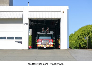 RICHMOND, BC/Canada - May 13, 2018: A fire truck and small fire hall in Richmond, British Columbia on Canada's west coast on May 13, 2018.