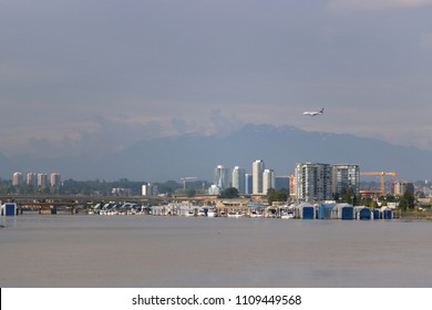 RICHMOND, BC/Canada - May 19, 2018: A 747 Westjet commercial passenger plane crosses over the city as it approaches Vancouver, Canada's international airport on May 19, 2018.