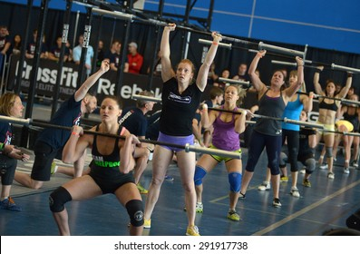 RICHMOND, CANADA - JUNE 7, 2013: Athletes compete during CrossFit tournament, June 7, 2013 in Richmond, BC, Canada.
