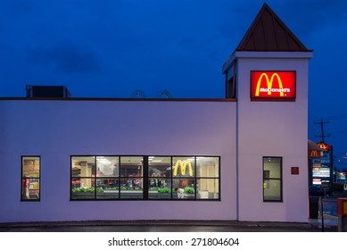RICHMOND HILL - APR 22: Small McDonalds restaurant with a square cupola photographed at night in Richmond Hill, Ontario on Apr. 22, 2015.