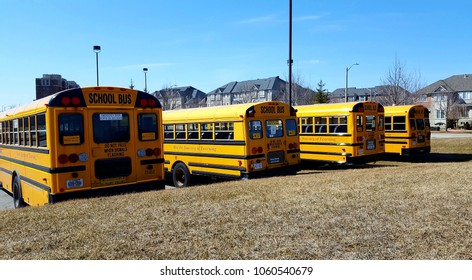 RICHMOND HILL, CANADA - APRIL 2, 2018: School buses in a parking lot,