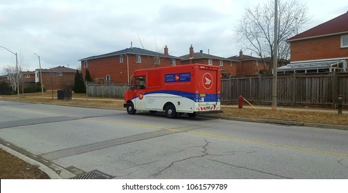 RICHMOND HILL, CANADA - MARCH 22, 2108: A Canada Post vehicle in a suburban area.