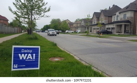 RICHMOND HILL, CANADA - MAY 22, 2018: Ontario election signs in a suburban street in Richmond Hill, Canada.
