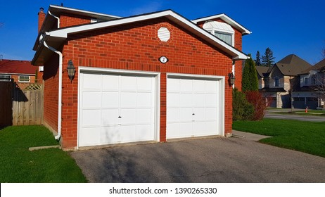 RICHMOND HILL, CANADA - MAY 6, 2019: The front of a detached house and the two garage doors in Richmond Hill,Canada.