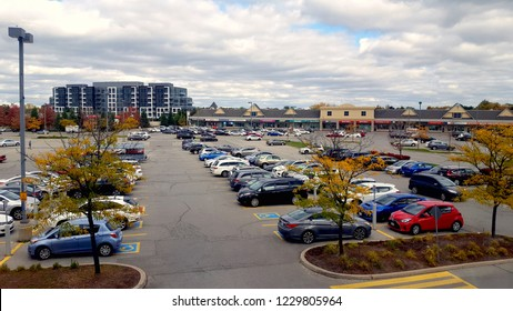RICHMOND HILL, CANADA - OCTOBER 13, 2018: Cars in a parking lot in a plaza in Richmond Hill, Canada.