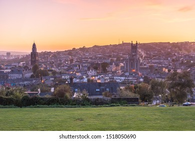 Richmond Hill, Cork, Ireland – September 2019: Beautiful sunset view of St Anne's Church bell tower, Roman Catholic Cathedral of St Mary and St Anne at dusk, stunning sunset sky, twilight, romantic