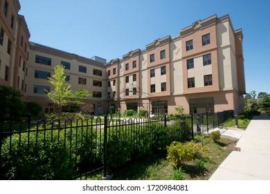 Richmond Hill, Ontario, Canada - 02/10/2011: Long-term care for seniors - Mon Sheong Richmond Hill Long term care center - building exterior, garden, landscaped, courtyard,