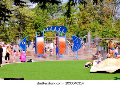 Richmond Hill, Ontario, Canada - August 29, 2021: Kids and family are playing at splash pads in lake wilcox park.