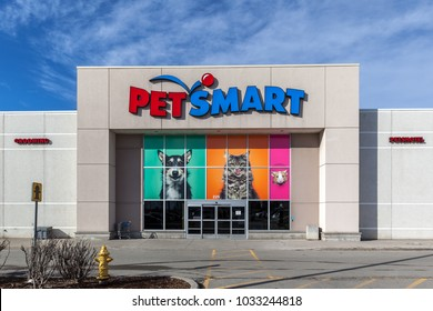 Richmond Hill, Ontario, Canada - February 24, 2018: PetSmart storefront.  PetSmart Inc. is an American retail chain that is engaged in the sale of pet animal products and services.