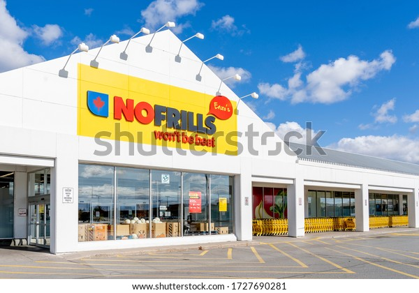 Richmond Hill, Ontario, Canada - October 14, 2019: Exterior of a No Frills grocery store in Richmond Hill. No Frills is a Canadian chain of discount supermarkets, owned by Loblaw Companies Limited.
