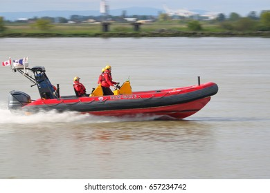 RICHMOND - June 10,2017: The Royal Canadian Marine Search and Rescue team speed across the Fraser River responding to a distress call  in Richmond, British Columbia on June 10, 2017.