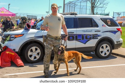 Richmond, KY US - March 31, 2018 - Easter Eggstravaganza A K9 Officer demonstrates canine techniques and training exercises with his K9 for a crowd, Mallinois bite dog, panting