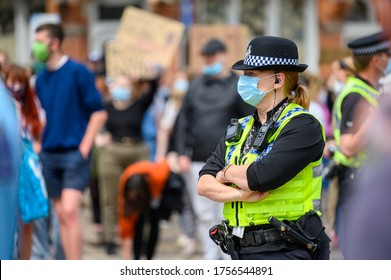 Richmond, North Yorkshire, UK - June 14, 2020: A female Police Officer wears a PPE Face Mask at a Black Lives Matter Protest