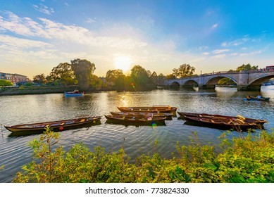 Richmond park river with boats during sunset in London - Shutterstock ID 773824330
