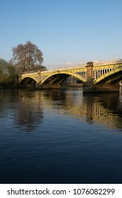 Richmond Railway Bridge reflected in the waters of the Thames.