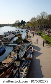 RICHMOND, SURREY, UK - APRIL 20, 2018: people strolling along the waterfront at Richmond on a sunny spring day.