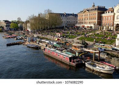 RICHMOND, SURREY, UK - APRIL 20, 2018: crowded waterfront at Richmond on a sunny spring day.