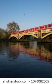 RICHMOND, SURREY, UK - APRIL 20, 2018: a Southwestern Railway train crossing the Richmond Railway Bridge.