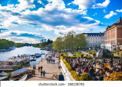 RICHMOND UPON THAMES, UK - APR 19: People enjoy the sunny weather in Richmond Upon Thames near London on April 19, 2014. The town is in proximity of a large number of parks, including Richmond Park