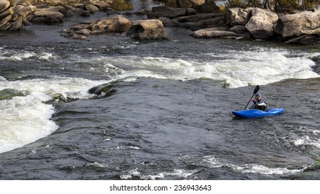 Richmond, USA - November 4, 2014: A man practicing rafting in Richmond, Virginia.