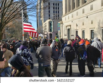 Richmond, VA - January 20, 2020: Streets of the city filled with protesters attending the Lobby Day gun rally. Armed supporters of the Second Amendment wave flags and march against gun laws.